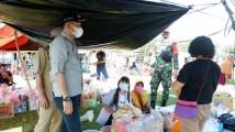 Jelang Hari Raya, Fokopimcam Jirak Jaya Gunakan Strategi ini untuk pengendalian Covid-19 di Pasar Kalangan